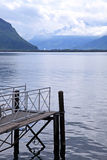 Old wooden jetty and Alps, Lake Geneva, Switzerland Stock Images