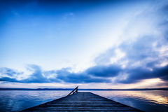 Old wooden jetty. At the chiemsee lake in bavaria Stock Image