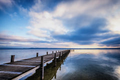 Old wooden jetty. At the chiemsee lake in bavaria Stock Photos