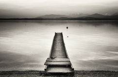 Old wooden jetty. At the chiemsee lake in bavaria Royalty Free Stock Photos