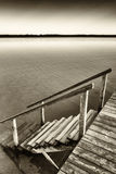 Old wooden jetty. At the chiemsee lake in bavaria Stock Photo