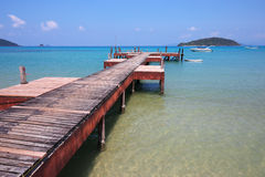 Old wooden jetty on exotic beach island Royalty Free Stock Images