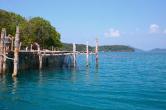 Old wooden jetty on exotic beach island Stock Photography