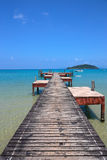 Old wooden jetty on exotic beach island Stock Photos
