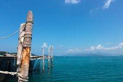 Old wooden jetty on exotic beach island Royalty Free Stock Photo