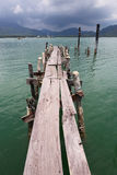 Old wooden jetty on exotic beach island Royalty Free Stock Photos