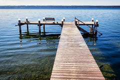 Old wooden jetty. At a lake Royalty Free Stock Photos