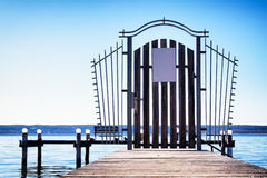 Old wooden jetty. At a lake Stock Photo