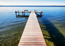 Old wooden jetty. At a lake Royalty Free Stock Images