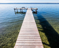 Old wooden jetty. At a lake Royalty Free Stock Photography
