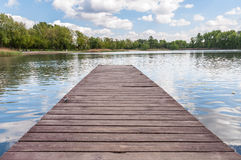 Old wooden jetty at a lake. In Sosnowiec, Poland Royalty Free Stock Photo