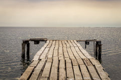 Old Wooden Jetty Leading To The Sea Stock Images