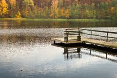 Old wooden jetty over the lake Stock Images