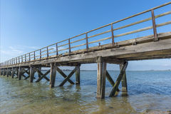 Old wooden jetty. Old weathered wooden jetty on the seafront Royalty Free Stock Photo