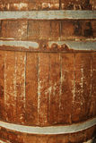 Old wooden keg. Old wooden barrel close-up, it is possible to use as a background Royalty Free Stock Photo