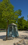 Old wooden kiosk. Reminiscences from the glorious past of the Versailles gardens. A blue wooden kiosk Royalty Free Stock Photography