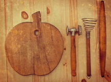 Old wooden kitchen utensils Stock Images