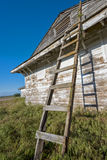 Old wooden ladded leans against a building Stock Image