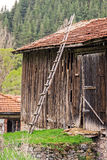Old wooden ladder in front of historic barn Royalty Free Stock Image