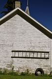 Old wooden ladder hanging on a shed wall Royalty Free Stock Photos