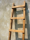 Old wooden ladder over the wall Royalty Free Stock Photography