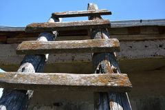Old wooden ladder pointed to the sky Royalty Free Stock Images