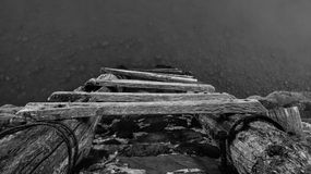 Old Wooden Ladder to the Waterline Royalty Free Stock Images