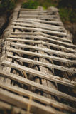 Old wooden ladder. Old wooden ladder used as a footbridge stock photography