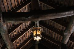 Old wooden lamp hanging roof. Old wooden lamp hanging on traditional Thai wood roof Stock Photo