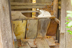 An old wooden latrine at a mining camp in the yukon Royalty Free Stock Images