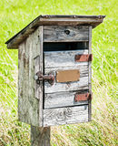Old wooden letterbox Stock Image