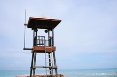 Old wooden lifeguard tower on a beach. In the sea royalty free stock photography