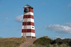 Old wooden lighthouse. An old wooden lighthouse in Denmark Royalty Free Stock Photos