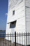 Old wooden lighthouse under blue sky Royalty Free Stock Photos