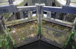 Old wooden lock gates on the rochdale canal. Old closed wooden lock gates on the rochdale canal Royalty Free Stock Images