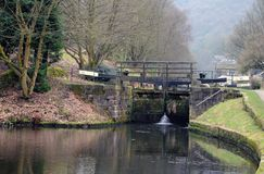 Old wooden lock gates on the rochdale canal near hebden bridge. With woodland landscape in winter Stock Photos
