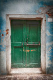 Old wooden locked green door Stock Photo