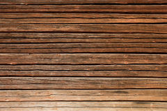 Old wooden log house wall. Old brown wooden log house wall horizontal Stock Photo
