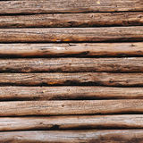 Old wooden logs background. Weathered wooden wall in brown color.