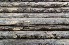 Old wooden logs wall. Wall built with old wooden decayed logs stock images
