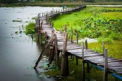 Old wooden  long  bridge. Stock Image