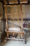 Old wooden loom. Prehistoric wooden loom in the ancient hut Royalty Free Stock Photos