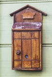 Old wooden mail box on the wall Stock Image