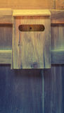 Old wooden mailbox on wood background .  ( Filtered image proces Royalty Free Stock Photo