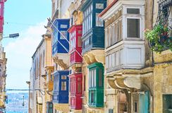 Maltese balconies, Valletta, Malta. The old wooden Maltese balconies are traditional element of stone historical edifices, their bright colors catch an eye of Royalty Free Stock Photography