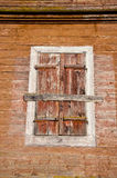 Old wooden manor house wall with windows shutter Royalty Free Stock Image