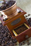 Old wooden manual coffee grinder. With coffee beans Stock Image