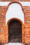 Old wooden medieval door with iron hinges. olszty, Poland. Stock Photography