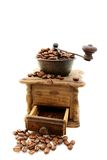 Old wooden mill with coffee beans. Stock Photo