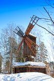 Old wooden mill on the Finnish forest in winter.  Stock Photo